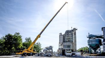 Liebherr mobile crane assembles concrete mixing plant