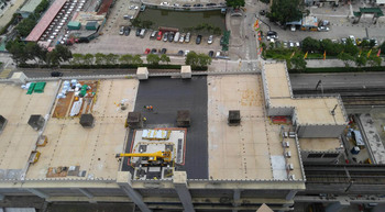 Grove rough-terrain crane on rooftop lifting job